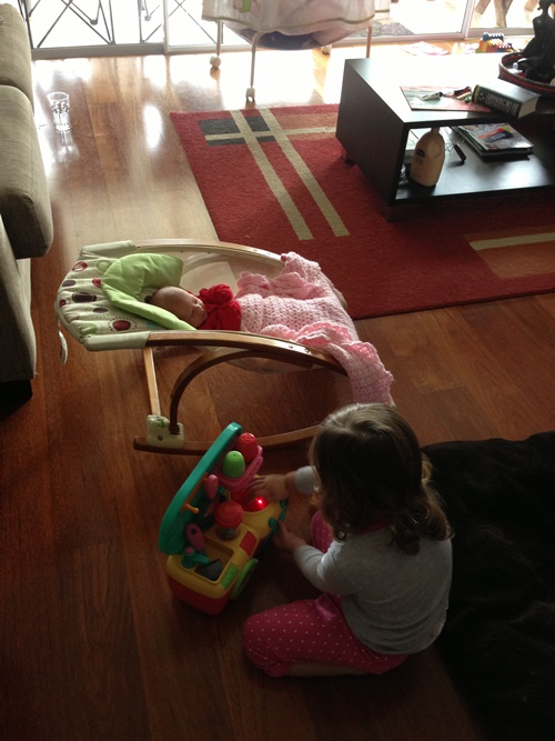 Another photo memory of my oldest wanting to play near her baby sister.
