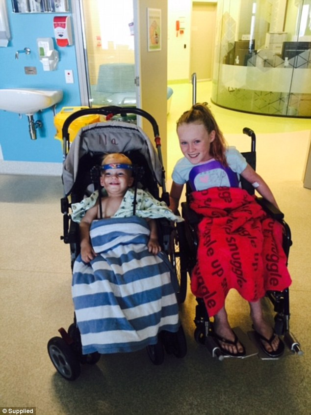 Jaxon and Shayne, still smiling despite their injuries. Image Source