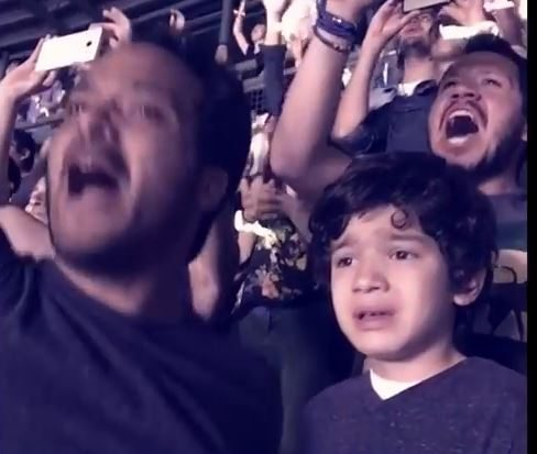 autistic boy enjoying coldplay concert