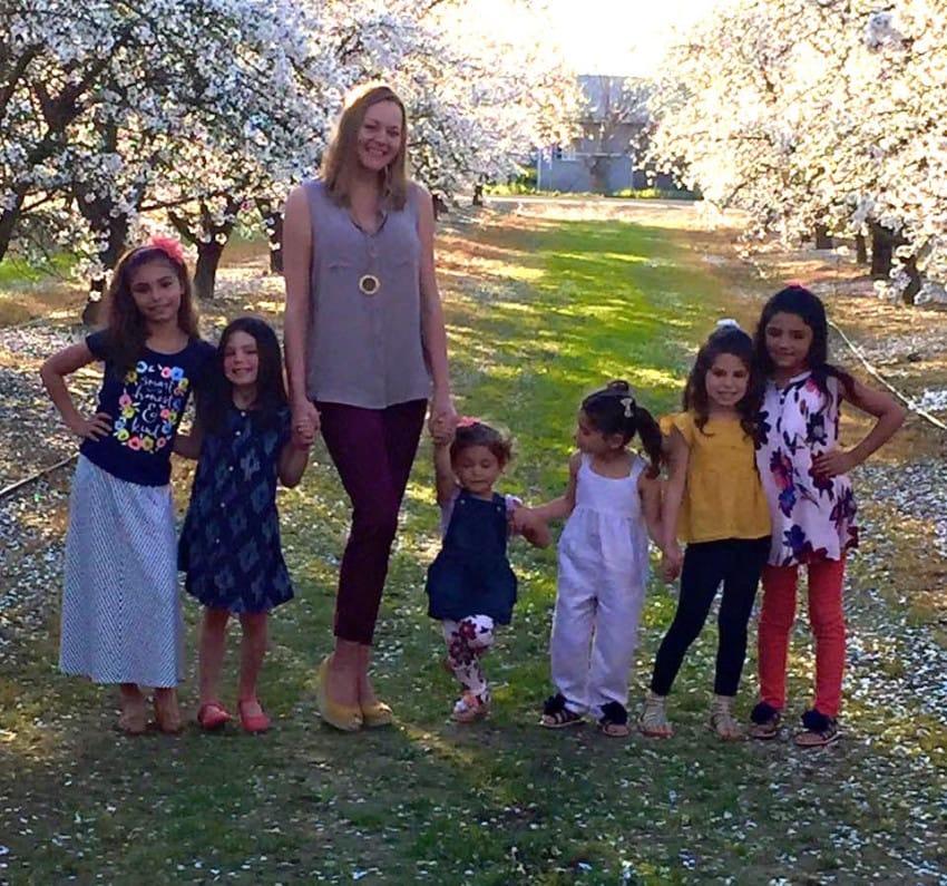 adopts six girls
